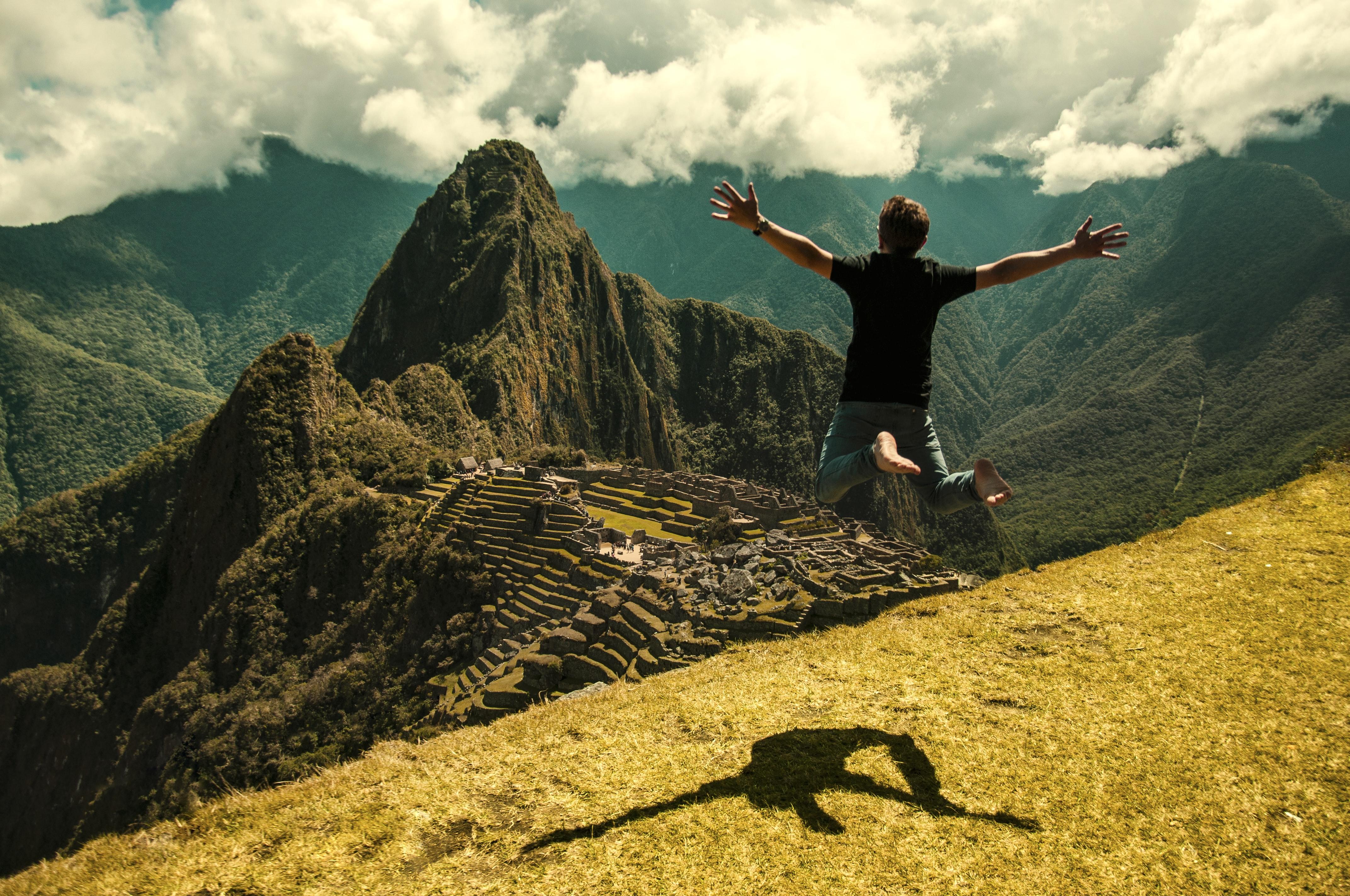 man jumping in green open field